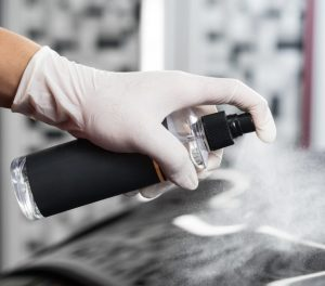 Applying Car coating spray on a car in pakistan
