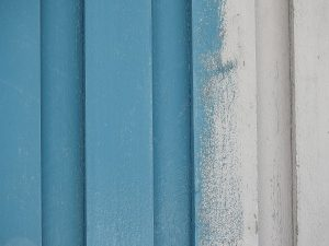 blue and white wood coatings on a timber wall